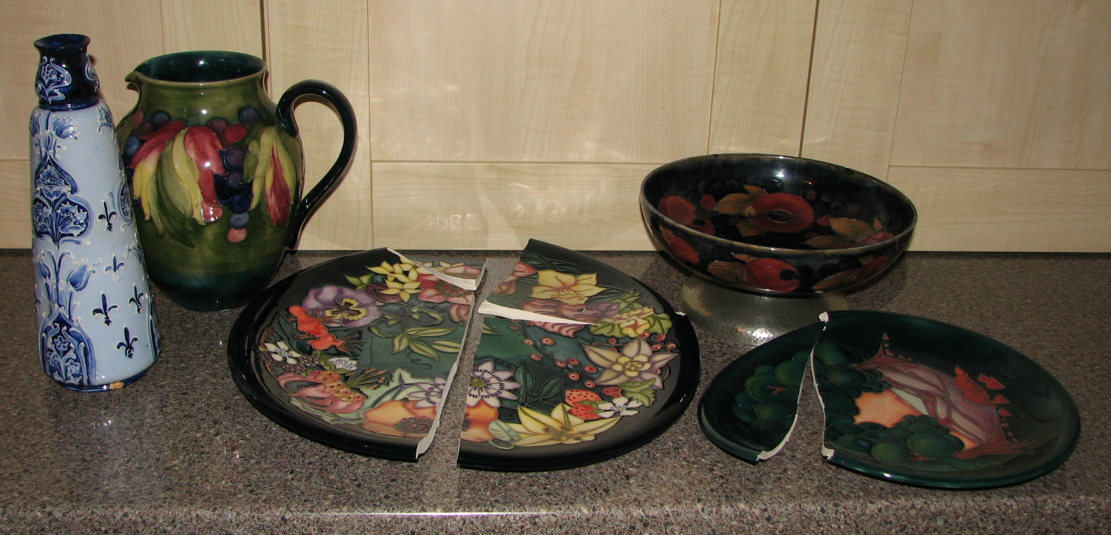 Various Moorcroft pieces in for repair and restoration